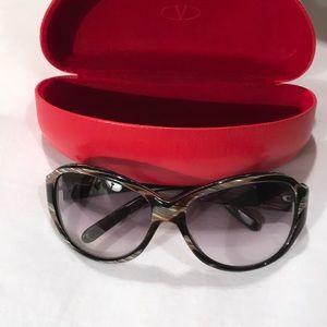 Valentino large frame glasses.